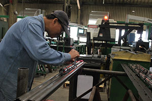 Man working on a perforating gun at Hunt & Hunt's facility